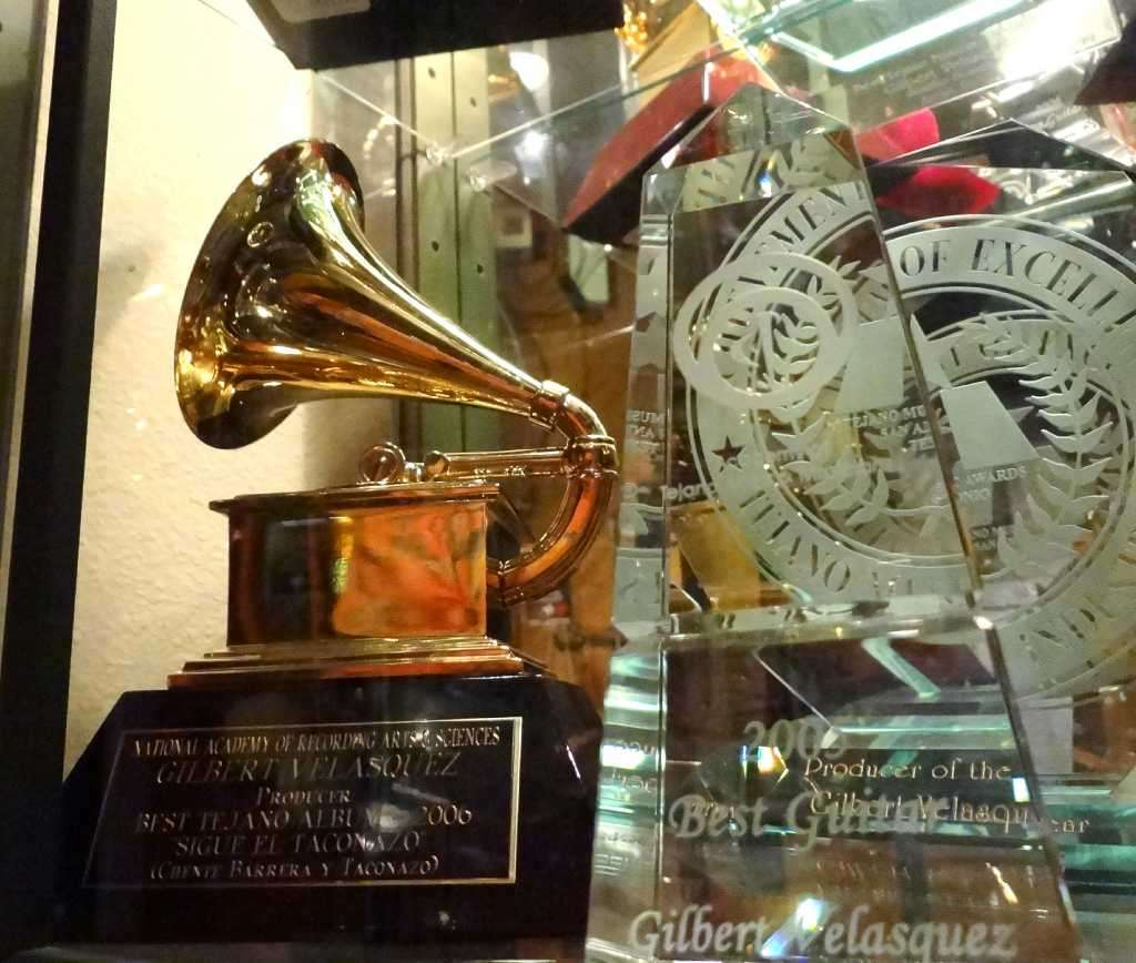 HONORS: The trophy case in Velasquez's studio holds many awards, including one of his Grammys. Photo: BILLY CALZADA, STAFF / gcalzada@express-news.net